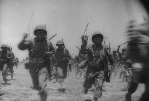 Above: Members of the Filipino 2nd Regiment charge with their bolos