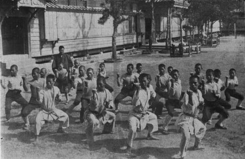 Vintage image of Okinawan karatekas, date unknown. Source: http://karatedo.hakuakai-matsubushidojo.com/history.html