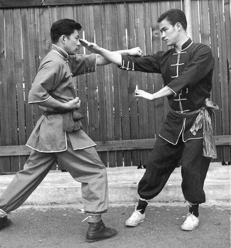 Bruce Lee demonstrates a finger jab against Taky Kimura. Source: https://www.pinterest.com/pin/384705993139347726/